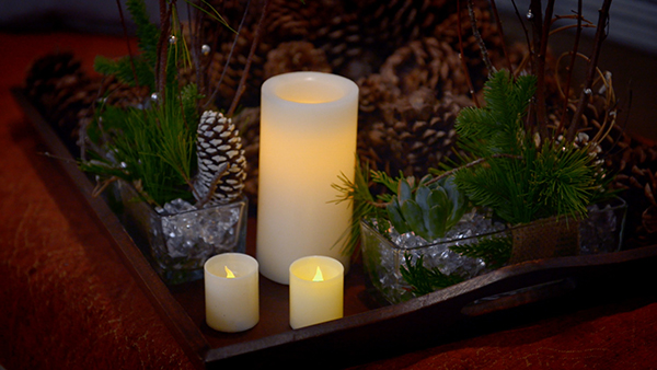 Candles of different heights add drama and richness to the setting.